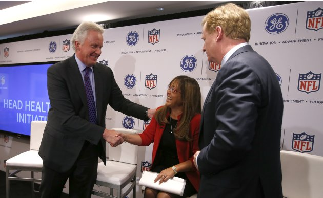 Jeff Immelt, Chairman and CEO of General Electric and Roger Goodell, Commissioner of the NFL, greet Sue Siegel, CEO of GE's Healthymagination during a news conference in New York