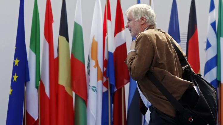 Finland's Foreign Affairs Minister Tuomioja arrives for an informal meeting of the EU Foreign Affairs Ministers in Milan