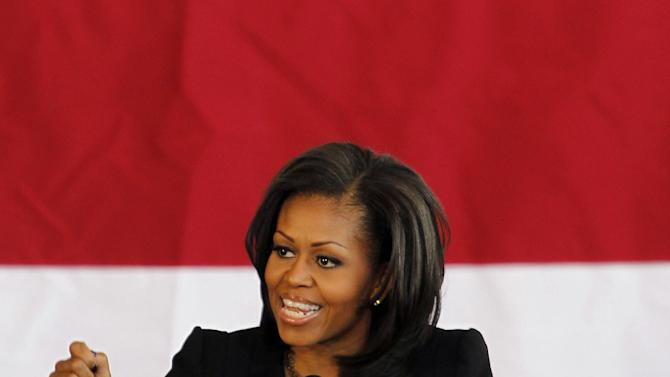 First lady Michelle Obama speaks at a campaign rally at a hangar near the Charlotte Douglas International Airport in Charlotte, N.C., Monday Nov. 5, 2012. (AP Photo/Bob Leverone)