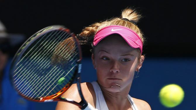 Katie Swan of Britain makes a forehand return to Tereza Mihalikova of Slovakia during the junior girls' singles final at the Australian Open tennis championship in Melbourne, Australia, Saturday, Jan. 31, 2015. (AP Photo/Vincent Thian)