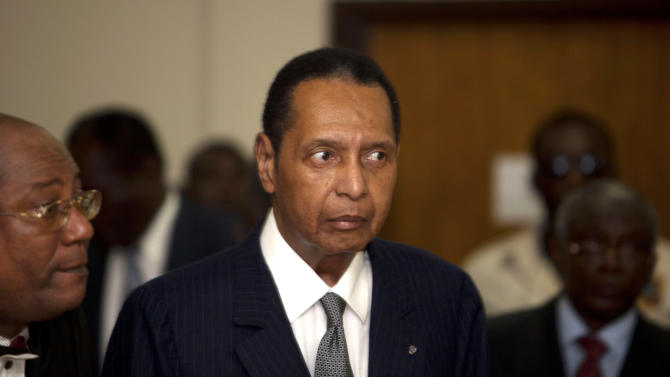 """FILE - In this Feb. 28, 2013 file photo, former Haitian dictator Jean-Claude Duvalier, known as """"Baby Doc,"""" attends his hearing at court in Port-au-Prince, Haiti. Alleged victims of the government of  Duvalier have resumed their testimony in court Thursday, March 14, 2013. Haitian authorities charged Duvalier with human rights abuses and embezzlement but a judge ruled he should face charges only for the alleged financial crimes. An appellate court is trying to decide if it should reinstate the abuse charges against Duvalier or drop the alleged financial crimes. (AP Photo/Dieu Nalio Chery, File)"""