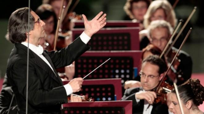 Leader of the pack:Riccardo Muti conducts his orchestra during a concert at the Vatican in May.