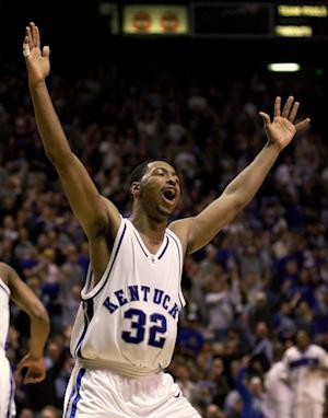 FILE - In this Dec. 18, 1999, file photo, Kentucky's Desmond Allison celebrates an assist in the first half of his team's 76-46 win over Louisville during an NCAA college basketball game in Lexington, Ky. Columbus, Ohio, police say former Kentucky player Allison was killed and another man was wounded in a shooting outside an apartment complex in Northeast Columbus on Monday, July 25, 2011. (AP Photo/Ed Reinke, File)