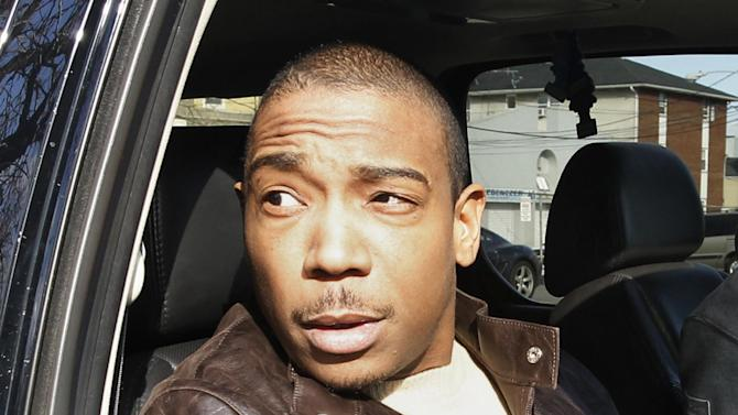FILE - This March 22, 2011 file photo shows rapper Ja Rule inside a vehicle outside Martin Luther King, Jr. Courthouse after pleading guilty to federal tax evasion charges in Newark, N.J. The Federal Bureau of Prisons says Ja Rule, whose real name is Jeffrey Atkins, left a correctional facility in New York's Adirondacks on Tuesday, May 7, 2013, though time remains on his sentence. Ja Rule had served most of a two-year sentence for illegal gun possession in a New York state prison before his release in February and subsequent transfer into federal custody in the tax evasion case.  (AP Photo/Julio Cortez, file)