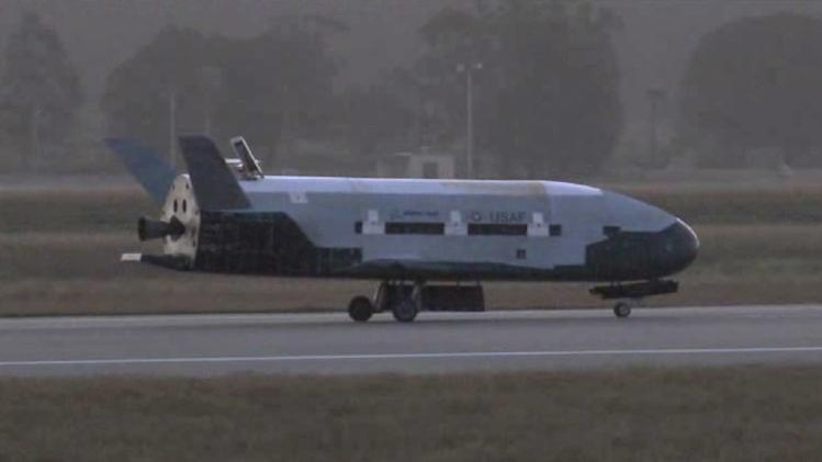 This Saturday, June 16, 2012 image from video made available by the Vandenberg Air Force Base shows the X-37B unmanned spacecraft landing at Vandenberg Air Force Base. The spacecraft, which was launched from Cape Canaveral Air Force Station in Florida in March 2011, conducted in-orbit experiments during the 15-month clandestine mission, officials said. It was the second such autonomous landing at the base. (AP Photo/Vandenberg Air Force Base)