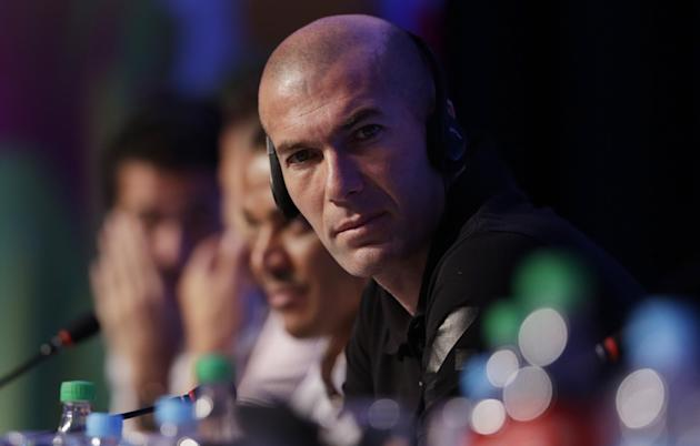Former soccer great and World Cup winner Zinedine Zidane of France listens to a question during a press conference one day before the draw for the 2014 soccer World Cup in Costa do Sauipe near Salvado