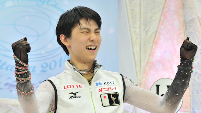 Japan's Yuzuru Hanyu reacts as he celebrates his first place following his performance in the men's free skating competition at the world figure skating championships in Saitama, on March 28, 2014