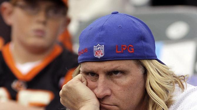A New York Giants fan watches in the closing minute of a 31-13 loss to the Cincinnati Bengals in an NFL football game on Sunday, Nov. 11, 2012, in Cincinnati. (AP Photo/Tom Uhlman)