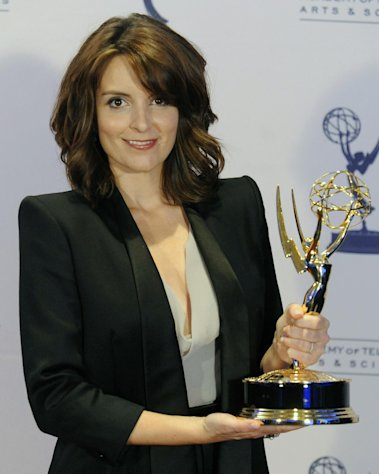 FILE - In this Sept. 12, 2009 file photo, Tina Fey poses backstage with her Emmy for Outstanding Guest Actress in a Comedy Series for her turn as former Alaska Gov. Sarah Palin on &quot;Saturday Night Live,&quot; at the Creative Arts Emmy Awards in Los Angeles. Television looks like the land of female opportunity with the success of shows like &quot;Girls&quot; and &quot;New Girl&quot; and the achievements of actor-writers including Tina Fey and Lena Dunham. but making TV remains largely man&#39;s work. (AP Photo/Chris Pizzello, File)