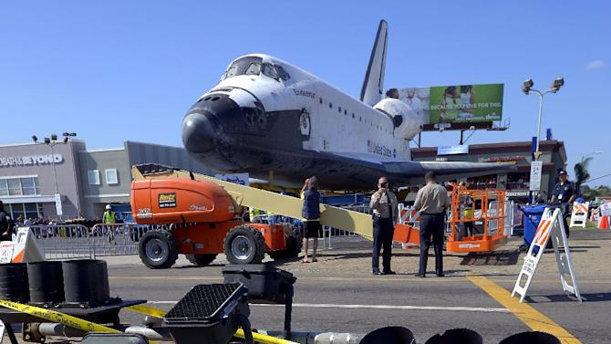 The Space Shuttle Endeavour sits before it is moved along city streets, Friday, Oct.12, 2012, in Los Angeles. Endeavour's 12-mile road trip kicked off shortly before midnight Thursday as it moved from its Los Angeles International Airport hangar en route to the California Science Center, its ultimate destination, said Benjamin Scheier of the center.  (AP Photo/Mark J. Terrill)