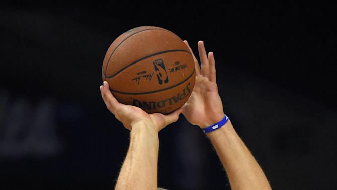 Los Angeles Clippers forward Blake Griffin shoots during warm-ups for the Clippers' NBA preseason basketball game against the Phoenix Suns, Wednesday, Oct. 22, 2014, in Los Angeles. (AP Photo/Mark J. Terrill)