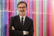 Longchamp chief executive Jean Cassegrain poses at Longchamp's second mega store in Hong Kong. Cassegrain said Longchamp is looking to expand its current presence of seven stores in mainland China -- including Beijing and Shanghai -- to about 40 to 50 stores, although he could not specify a timeline