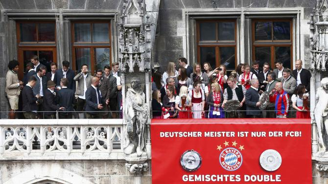 Bayern Munich's men and women team players celebrate winning the German Bundesliga title in front of the town hall, in downtown Munich