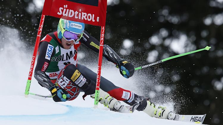 Ted Ligety, of the US, speeds down the course during the first run of an alpine ski, men's World Cup giant slalom, in Alta Badia, Italy, Sunday, Dec. 22, 2013. (AP Photo/MarcoTrovati)