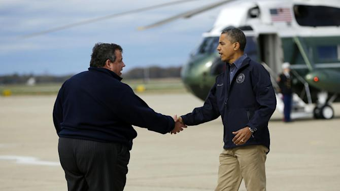 President Barack Obama is greeted by New Jersey Gov. Chris Christie upon his arrival at Atlantic City International Airport, Wednesday, Oct. 31, 2012, in Atlantic City. Obama traveled to region to take an aerial tour of the Atlantic Coast over areas damaged by superstorm Sandy,  (AP Photo/Pablo Martinez Monsivais)