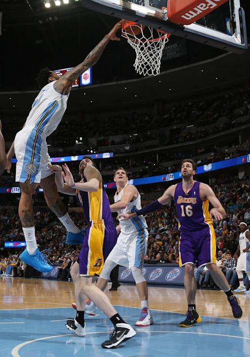 Denver Nuggets forward Wilson Chandler, left, dunks the ball for a basket over Los Angeles Lakers forward Ryan Kelly, second from left, as Nuggets center Timofey Mozgov, third from left, of Russia, an