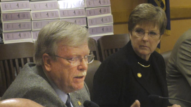 In this Wednesday March 30, 2011 file photo, Kansas Senate Judiciary Committee Chairman Tim Owens, left, an Overland Park Republican, discusses drunken driving legislation during a caucus of fellow GOP senators at the Statehouse in Topeka, Kan. Frustrated by their inability to achieve some policy goals, conservatives in Republican states are turning against moderate members of their own party, trying to drive them out of state legislatures to clear the way for reshaping government across a wide swath of mid-America controlled by the GOP. Moderate GOP incumbent Sen. Tim Owens, one of the targets.  (AP Photo/John Hanna)