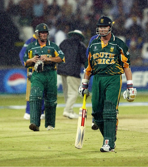 Lance Klusener and team-mate Mark Boucher of South Africa leave the field as rain falls [Mark Boucher's retirement]