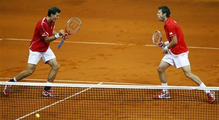 Canada's Pospisil and Nestor celebrate a point against Serbia's Zimonjic and Bozoljac during their Davis Cup semi-final doubles match in Belgrade