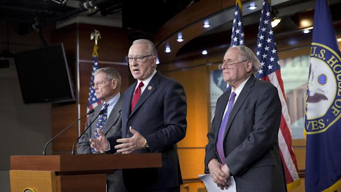 "House Armed Services Committee Chairman Howard P. ""Buck"" McKeon, R-Calif., center, joined at right by Senate Armed Services Committee Chairman Carl Levin, D-Mich., right, with Sen. James Inhofe, R-Okla., left, the ranking member of the panel, tells reporters they have reached an agreement on funding the Pentagon budget, at a news conference on the Defense Authorization Bill, at the Capitol in Washington, Monday, Dec. 9, 2013. (AP Photo/J. Scott Applewhite)"