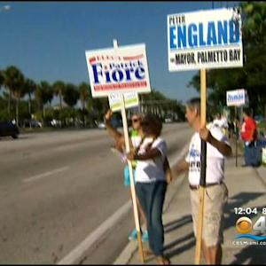 Scott, Crist Rally Support In Miami On 1st Day Of Early Voting