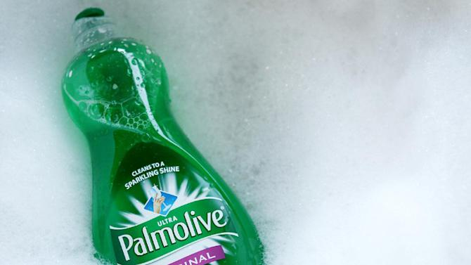 FILE - In this Jan. 26, 2011 file photo, a bottle of dish liquid Palmolive is surrounded by soap suds in Phoenix. Colgate-Palmolive Co. suffered a 5 percent fall in fourth-quarter net income Thursday, Jan. 26, 2012, which it blamed on higher costs for making and packaging its products. (AP Photo/Ross D. Franklin, File)