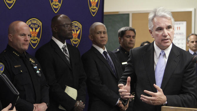 San Francisco District Attorney George Gascon, right, speaks during a news conference regarding the arrests of suspects in the killing of German tourist Mechthild Schröer at the Hall of Justice in San Francisco, Wednesday, May 4, 2011. Also pictured is San Francisco Police Chief Greg Suhr, left. (AP Photo/Jeff Chiu)