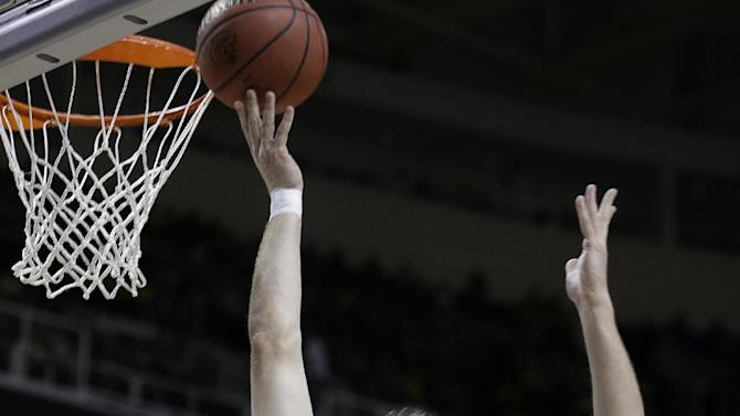 Saint Louis forward Rob Loe (51) lays up a shot aganst Oregon during the first half of a third-round game in the NCAA college basketball tournament Saturday, March 23, 2013, in San Jose, Calif. (AP Photo/Ben Margot)