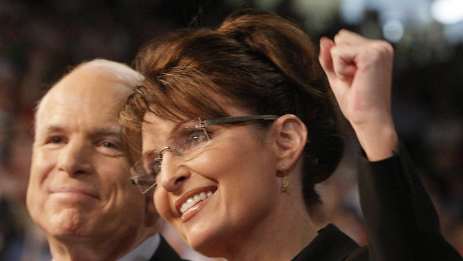 FILE - In this Aug. 29, 2008 file photo, Republican presidential candidate Sen. John McCain, left, smiles as his choice for his vice presidential running mate, Alaska Gov. Sarah Palin, pumps her fist as she is introduced to supporters at a campaign rally in Dayton, Ohio.  Four years after Palin, it might certainly feel to voters as though the choice of a presidential ticket's No. 2 can be a make-or-break decision for the ticket's No. 1.   But the conventional wisdom among those who study this stuff is that, in truth, the veep choice actually doesn't do much, if anything at all, to change the outcome of an election. (AP Photo/Stephan Savoia, File)