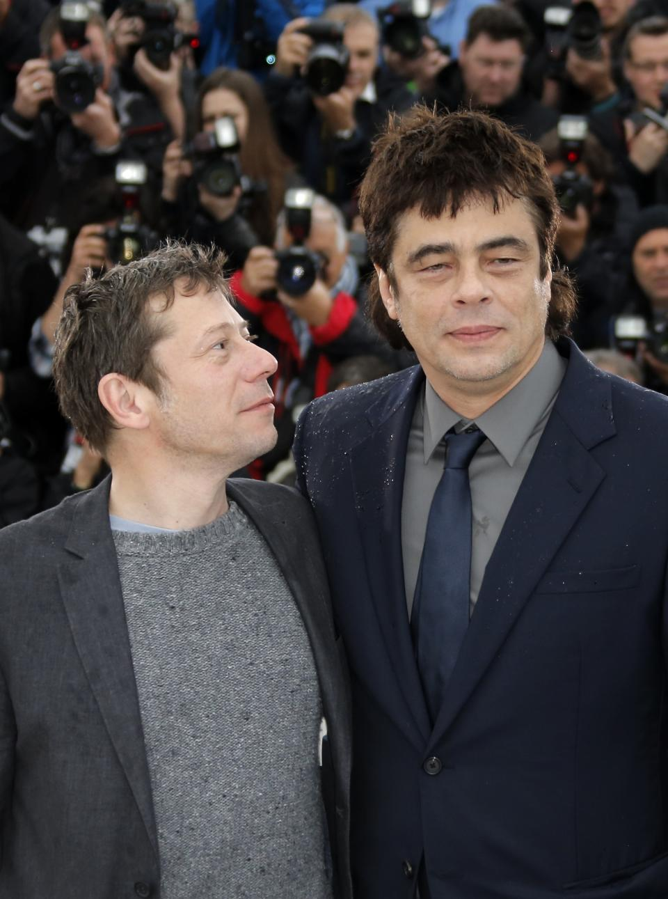 Actors Mathieu Amalric, left, and Benicio Del Toro pose for photographers during a photo call for the film Jimmy P. Psychotheraphy of a Plains Indian at the 66th international film festival, in Cannes, southern France, Saturday, May 18, 2013. (AP Photo/Francois Mori)