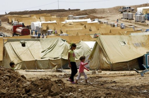 Syrian-Kurdish refugee children walk past tents in a refugee camp in northern Iraq on July 17. After the Russian and Chinese veto of a UN resolution on Syria, America must use back channels to bolster its support for rebel forces as US military involvement is not an option, analysts said
