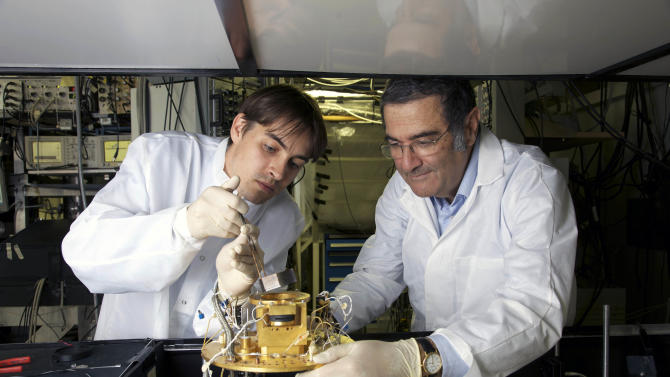 This 2009 photo provided Tuesday Oct. 9, 2012 by the CNRS (Centre Nationale de la Recherche Scientifique) shows French physician Serge Haroche, right, and his aide Igor Dotsenko in Paris. Haroche and U.S David wineland share the 2012 Nobel Prize in physics Tuesday Oct. 9, 2012 for inventing methods to observe the bizarre properties of the quantum world, research that has led to the construction of extremely precise clocks and helped scientists take the first steps toward building superfast computers. (AP Photo/CNRS/ Christophe Lebedinsky) EDITORIAL USE ONLY - NO USE AFTER DEC.31 2012