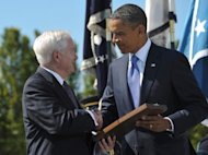 US President Barack Obama presents the Medal of Freedom to outgoing defense secretary Robert Gates, June 30, 2011, at the Pentagon in Washington, DC (AFP Photo/Mandel Ngan)