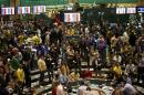 Oil traders work in the pit of the New York Mercantile Exchange in New York