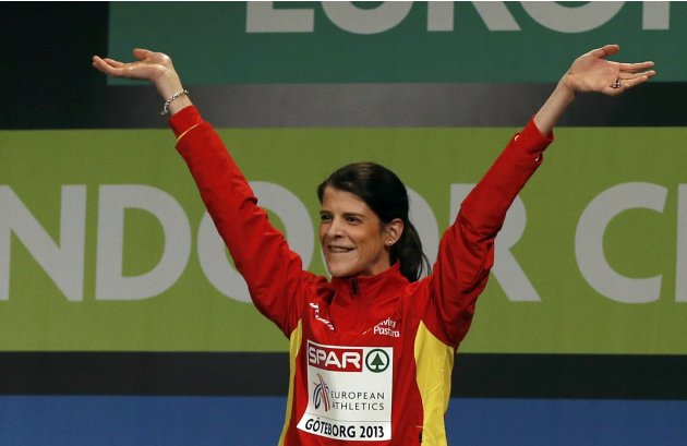 Winner Ruth Beitia of Spain celebrates on the podium during the medal ceremony after the women's High Jump event at the European Athletics Indoor Championships in Gothenburg