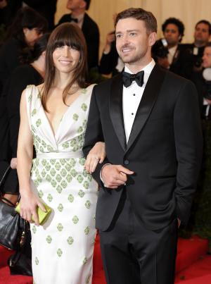 """FILE - In this May 7, 2012, file photo, Jessica Biel and Justin Timberlake arrive at the Metropolitan Museum of Art Costume Institute gala benefit, celebrating Elsa Schiaparelli and Miuccia Prada in New York. Biel says that before Timberlake proposed, she didn't expect to ever get married. The 30-year-old actress told The Associated Press on Friday that she feels """"wonderful"""" about the engagement. The couple reportedly became engaged late last year but rarely speak publicly about their relationship. (AP Photo/Evan Agostini, File)"""
