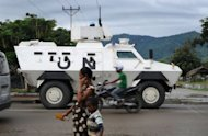 A UN armored vehicle patrols the streets of Dili in March 2012. UN peacekeepers will hand over full responsibility for policing to East Timor next week as they begin withdrawing in earnest from Asia's youngest nation, a UN official said Tuesday