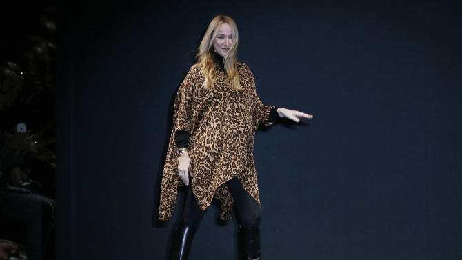 Italian fashion designer Frida Giannini acknowledges the audience after presenting her Gucci men's Fall-Winter 2013-14 collection, part of the Milan Fashion Week, unveiled in Milan, Italy, Monday, Jan. 14, 2013. (AP Photo/Antonio Calanni)