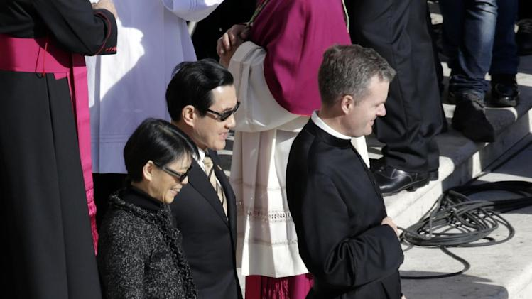 Taiwan's President Ma Ying-jeou and his wife Chow Mei-chin arrive in St. Peter's Square for Pope Francis' inaugural Mass, at the Vatican, Tuesday, March 19, 2013. (AP Photo/Andrew Medichini)