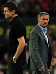 Real Madrid&#39;s Portuguese coach Jose Mourinho (R) reacts past Barcelona&#39;s coach Tito Vilanova during the Spanish League Clasico football match FC Barcelona vs Real Madrid CF at the Camp Nou stadium in Barcelona. The game ended in a draw 2-2