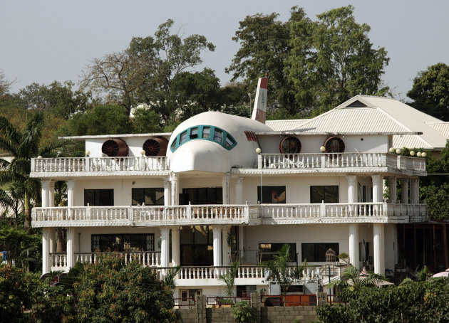 A house partially built in the shape of an airplane is seen in Abuja