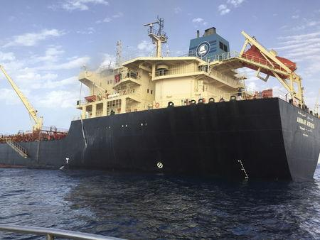 Smoke rises from oil tanker Anwar Afriqya after a Libyan warplane attacked the tanker in Sirte