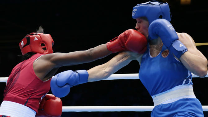 The United States' Claressa Shields, in red, fights Russia's Nadezda Torlopova, in blue, in a women's middleweight 75-kg boxing gold medal match at the 2012 Summer Olympics, Thursday, Aug. 9, 2012, in London. (AP Photo/Ivan Sekretarev)