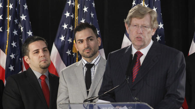 FILE – In this Feb. 7, 2012, file photo Ted Olson, right, lead Co-Counsel for the American Foundation for Equal Rights, seen with Proposition 8 paintiffs, Jeff Zarrillo, left, and Paul Katami, middle, comments on the announcement that California's same-sex marriage ban is unconstitutional during a American Foundation for Equal Rights conference in Los Angeles. A continuing distinct partisan divide is present in the gay marriage cases at the U.S. Supreme Court, set for arguments March 26-27, 2013, even though a brief on behalf of more than 100 prominent Republicans calls for marriage equality. The split is most in evidence in legal briefs filed with the court by state attorneys general.  (AP Photo/Damian Dovarganes, File)
