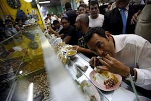 Guatemalan presidential candidate Jimmy Morales eats…