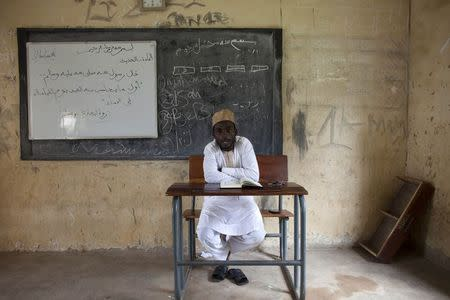 A teacher at Maska Road Islamic School teaches Hadith excerpts in a classroom in Kaduna