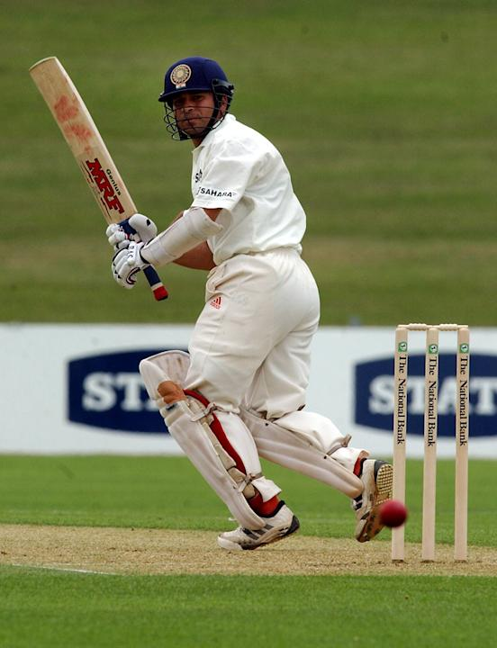 India's Sachin Tendulkar turns the ball down leg s
