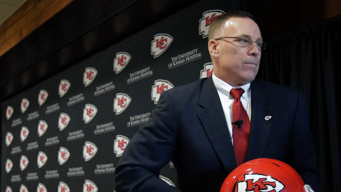New Kansas City Chiefs general manager John Dorsey leaves the stage after an NFL football news conference Monday, Jan. 14, 2013, in Kansas City, Mo. (AP Photo/Charlie Riedel)