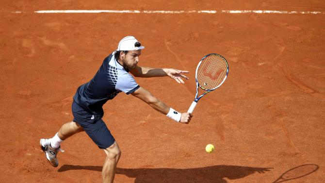 Joao Sousa of Portugal plays a shot to Andy Murray of Britain during their men's singles match at the French Open tennis tournament at the Roland Garros stadium in Paris
