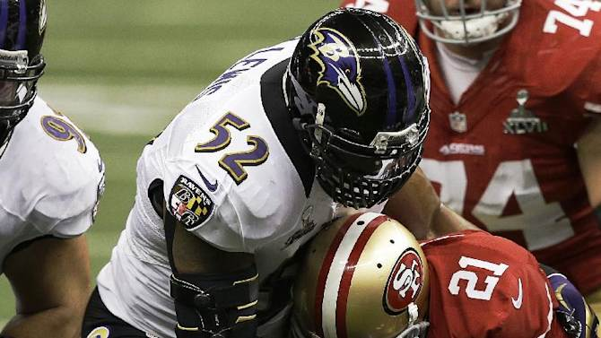 Baltimore Ravens inside linebacker Ray Lewis (52) tackles San Francisco 49ers running back Frank Gore (21) during the first half of the NFL Super Bowl XLVII football game, Sunday, Feb. 3, 2013, in New Orleans. (AP Photo/Elise Amendola)